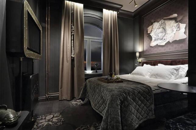 текстиль в интерьере спальни в черных тонах